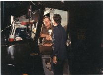 Congressman Jim Slattery introduces himself to package car driver, Noel Hamm during the 1987 Founders' Day celebration at Topeka.