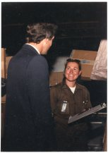 Package car driver, Denise Melvin, shows a delivery record to Congressman Jim Slattery during Founders' Day, 1987.