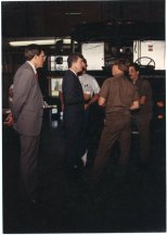 UPS package car drivers, Tom Shehi (back to camera) and Jim Figgs speak with Congressman Jim Slattery at the Topeka center. To the far left is UPS manager, Bill Perry, and Teamster Local 696 President, Bill Moore stands behind Slattery.