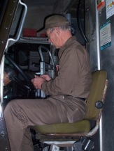 Tom Shehi, longtime UPS driver, sits behind the wheel of his package car on his last day at work.