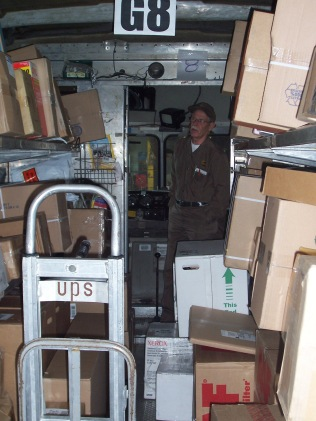 UPS driver Tom Shehi looks at the packages in his load on his last day at work. Even the easy days weren't easy at UPS.