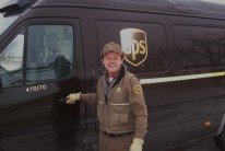 UPS driver, Greg Hoots stands beside car number 470170, the final 2003 Freightliner Sprinter package car in Kansas. Hoots was the 'last mile' driver of the Sprinter fleet.