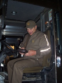 John Hertlein signs into his DIAD on his final day of work at UPS.