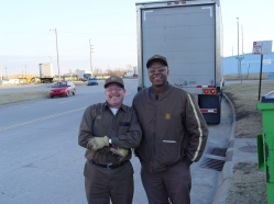 Bob Kramer, left, and Clarence Banks, both longtime Topeka feeder drivers, pause behind a trailer parked along the east side of the UPS building in Topeka.