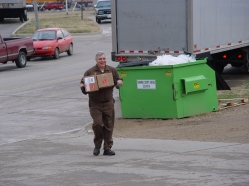 Topeka feeder driver, Pat McCoy, brings two Next Day Air packages into the Topeka center.