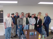 The Topeka feeder department pose for a group photo. They include from left to right, Pat McCoy, Dave Larkin, Mike Garrett, Bob Kramer, Dan Holland, Terry Manspeaker, Clarence Banks, Earl Lamar, Ken McKee, Barbara Lay, Jim Desch, and Lester Fields.