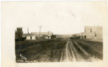 This 1907 real photo postcard by John Bowers looks south from the 300 block of Main Street.