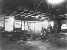 This interior view of the shop at Alma Tire and Battery Shop, located at 204-206 Missouri Street in Alma, Kansas was taken by Alma photographer, Gus Meier in 1925.