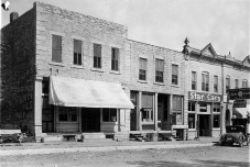 "The ""Palenske Block"", located at 204-212 Missouri Street in Alma, Kansas was built for Alma businessman and banker, Louis Palenske. When this photo was taken in 1925, the buildings contain, from the left, Ketterman's Restaurant, Gus Meier Photo Gallery, Steinmeyer Bros Star Car dealership, and Alma Tire & Battery."