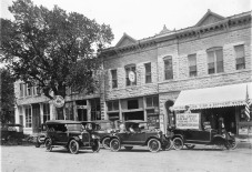 "This photo of a group of Star automobiles parked in front of the Steinmeyer Bros. Star dealership and their Alma Tire & Battery Shop was taken by Alma photographer Gus Meier in 1925. Notice the car at the far right holds a sign asking, ""can u-r car do this?"" and the car is standing balanced on three wheels with the right front wheel removed."