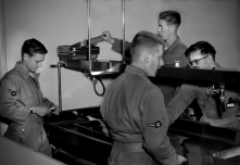 Dave mathias, far left, and other Air Force photographer trainees attend darkroom class at Lowery AFB in this 1956 photograph.