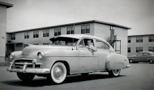 Dave Mathias is seen in this view in his 1950 Chevrolet as he drives away from his barracks building in the summer of 1957.