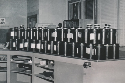These stacks of drums all contain film from RB-47 reconnaissance aircraft to be processed at the Air Force photo lab, located in the 815th Reconnaissance Technical Squadron building at Forbes AFB. Smaller reels of 35-millimeter film are stacked on top of the 10-inch film cans. This 1957 view shows one night's work for Air Force photographer, Dave Mathias.