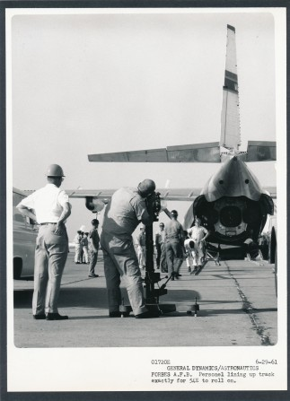 This is one of three photos Dave Mathias took of a missile being unloaded from the belly of a C-133 transport plane at Forbes AFB on 6-29-61.