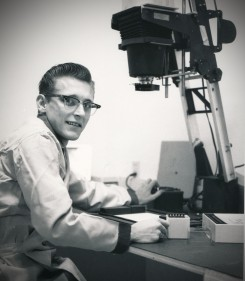 Dave Mathias sits at the enlarger at the GDA photo lab at Forbes AFB in 1961.