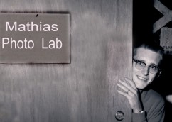 Dave Mathias peers out the doorway of the GDA photo lab, located in Building 13 at Forbes AFB, in this view from 1961.