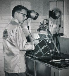 Dave Mathias is seen working in the photo lab at Schilling AFB in this view dated 1962.
