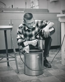 In this 1962 view, Dave Mathias is seen mixing chemicals in the GDA photo lab at Schilling AFB.