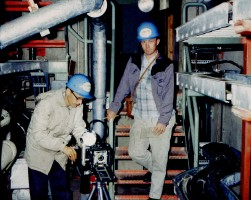 Dave Mathias, left, prepares his camera for a photograph inside a missile silo at Schilling AFB at Salina, Kansas in 1962.