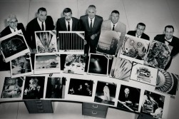 Dave Mathias, second from right, and his fellow General Dynamics photogrpahers pose with their award-winning photos in this view from 1963.