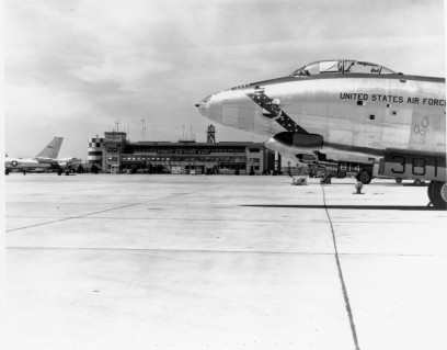 An RB-47 Reconnaissance jet sits on the flight line in front of the operations building at Forbes Air Force base. Notice that the air traffic tower was located on the end of the operations building.