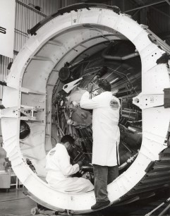 Two engineers from General Dynamics work on an Atlas missile at the GDA factory in San Diego in 1964.