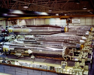 Newly manufactured rockets form a line at the General Dynamics Astronautics factory at San Diego in this view, circa 1964.