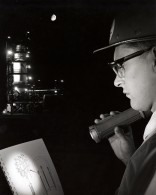 A General Dynamics test engineer refers to a check list during a test launch at San Diego in 1964.