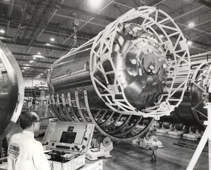 General Dynamics Astronautics engineers work on the Centaur booster assembly line in this 1964 view.
