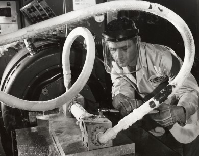 A GDA engineer performs a liquid nitrogen test on the Centaur booster engine in this 1964 view by Dave Mathias.