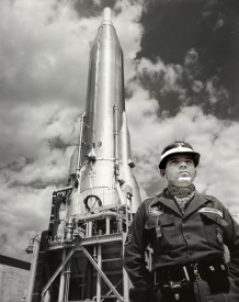 A guard from the 310th Security Forces Squadron stands guard next to Atlas-F missile number 513 at Schilling AFB in this view from 1962.