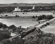 Dave Mathias took this photo from an Air Force helicopter while an Atlas missile was being transported to a silo near Schilling AFB in 1962.