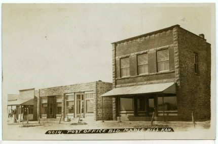 "Elmer ""Hickory"" Jones worked and resided at the Dolley & Stewart mercantile in the late 1890s, the two-story building at the far right in this 1908 postcard view by J. Bowers."
